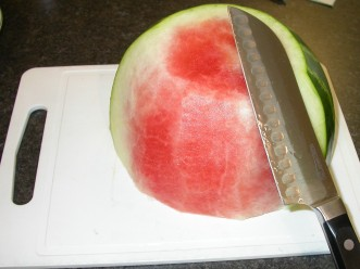 Watermelon and Cucumber Salad - peeling watermelon